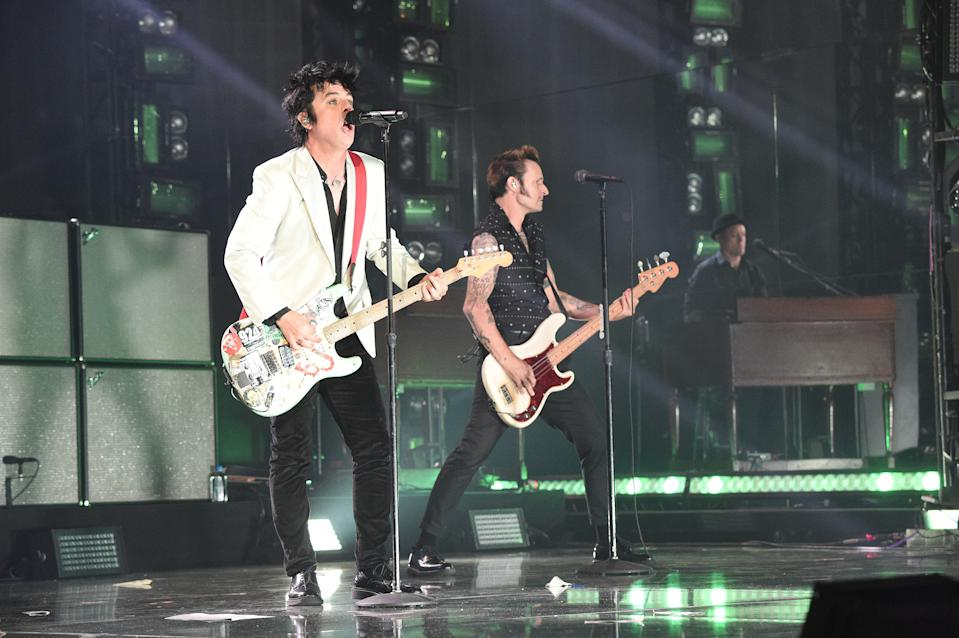 LOS ANGELES, CALIFORNIA - NOVEMBER 24: Billie Joe Armstrong and Mike Dirnt of Green Day perform onstage during the 2019 American Music Awards at Microsoft Theater on November 24, 2019 in Los Angeles, California. (Photo by Kevin Mazur/AMA2019/Getty Images for dcp)