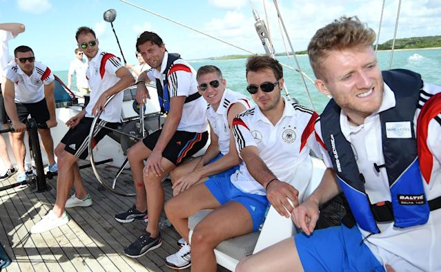 German national soccer players Lukas Podolski, from left, Benedikt Hoewedes, Roman Weidenfeller, Bastian Schweinsteiger, Mario Goetze and Andre Schuerrle sit on a boat in Santo Andre near Porto Seguro, Brazil, Tuesday, June 10, 2014. The German team got some motivation help from explorer and adventurer Mike Horn during a sailing outing near their camp on Brazil's Atlantic coast. (AP Photo/Markus Gilliar, pool)