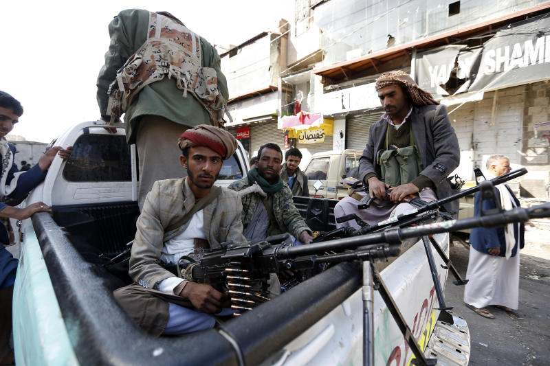 Houthi rebel fighters wait outside former President Ali Abdullah Saleh's residence in Sanaa on Monday. (MOHAMMED HUWAIS via Getty Images)
