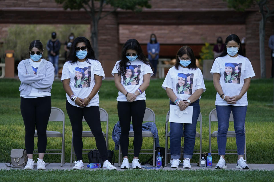 People bow their heads in prayer during a ceremony Thursday, Oct. 1, 2020, on the anniversary of the mass shooting three years earlier in Las Vegas. The ceremony was held for survivors and victim's families of the deadliest mass shooting in modern U.S. history. (AP Photo/John Locher)