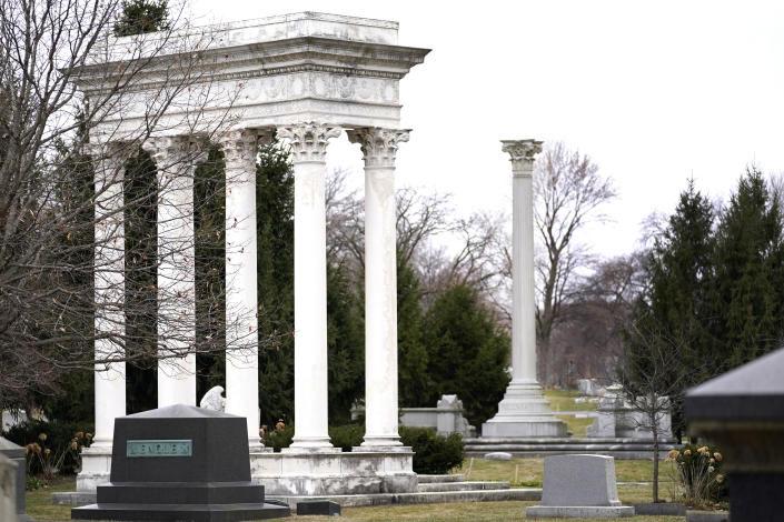 The towering burial monuments for William Kimball, left, the piano, reed and pipe organ manufacturer, and George Pullman, right, renowned for his luxury railcars, rise high in the deepest section of Graceland Cemetery, on Chicago's Northside Monday, March 15, 2021. Graceland quickly became the preeminent place of burial for Chicago's elite starting in the late 1800's. (AP Photo/Charles Rex Arbogast)