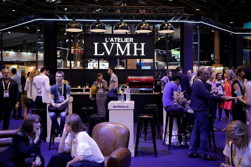 Attendees visit the LVMH Moet Hennessy Louis Vuitton SE technology workshop at the Viva Technology conference in Paris
