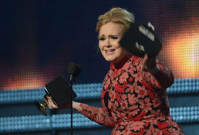 Adele receives the Grammy for best pop solo performance during the 55th Grammy Awards in Los Angeles, California, February 10, 2013