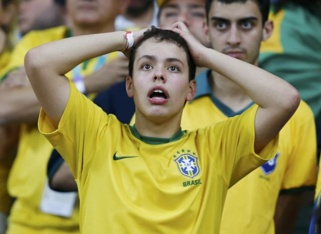A fan of Brazil reacts during their 2014 World Cup semi-finals against Germany at the Mineirao stadium in Belo Horizonte July 8, 2014. REUTERS/Marcos Brindicci (BRAZIL - Tags: SOCCER SPORT WORLD CUP)