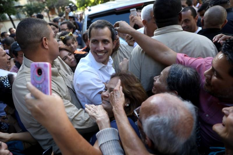 Juan Guaido, president of Venezuela's National Assembly share with supporters after a citizen assembly in Caracas