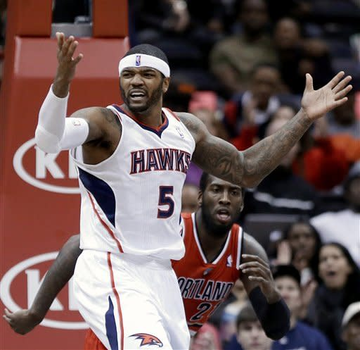 Atlanta Hawks' Josh Smith looks for a foul call from the officials after missing a shot against Portland Trail Blazers' J.J. Hickson, rear, in the fourth quarter of an NBA basketball game, Friday, March 22, 2013, in Atlanta. (AP Photo/David Goldman)