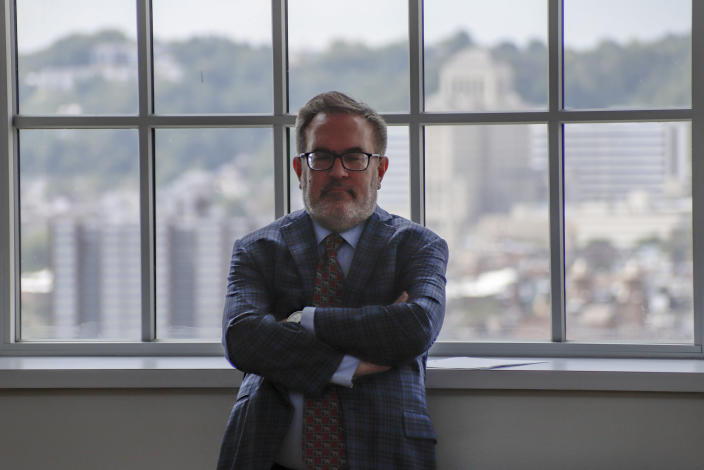 The skyline of Pittsburgh's north side is visible in the windows of the Energy Innovation Center as Andrew Wheeler, the EPA Administrator, listens as other officials speak about the rollback of the 2016 methane emissions rules to undo Obama-era rules designed to limit greenhouse gas emissions from oil and gas fields and pipelines at Thursday, Aug. 13, 2020, in Pittsburgh. (AP Photo/Keith Srakocic)