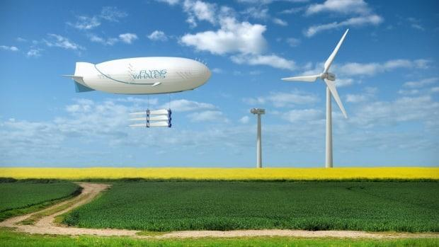 This rendering shows the airship carrying giant blades for wind turbines. The vehicle will be able to carry 60 tons, according to the company. (Submitted by Flying Whales - image credit)