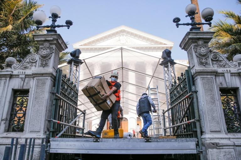 Workers on July 2, 2021 preparing the site near Chile's former Congress building in Santiago for the installation of the new Constitutional Convention