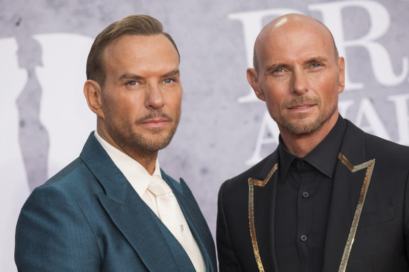 Matt Goss and Luke Goss pose for photographers upon arrival at the Brit Awards in London, Wednesday, Feb. 20, 2019. (Photo by Vianney Le Caer/Invision/AP)