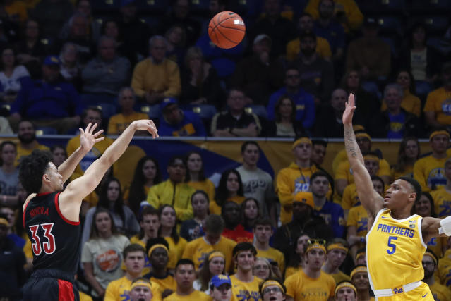 Louisville's Jordan Nwora (33) a 3-pointer over Pittsburgh's Au'Diese Toney (5) during the first half of an NCAA college basketball game Tuesday, Jan. 14, 2020, in Pittsburgh. (AP Photo/Keith Srakocic)