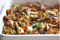 """<p>Apples lend sweetness to this herb-flecked stuffing made with chewy focaccia bread.</p><p>Get the <a href=""""http://www.delish.com/uk/cooking/recipes/a28926334/apple-sausage-focaccia-stuffing-recipe/"""" rel=""""nofollow noopener"""" target=""""_blank"""" data-ylk=""""slk:Apple & Sausage Focaccia Stuffing"""" class=""""link rapid-noclick-resp"""">Apple & Sausage Focaccia Stuffing</a> recipe. </p>"""