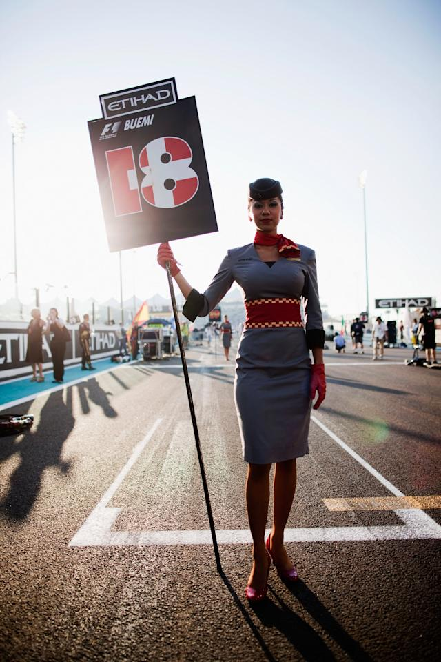 ABU DHABI, UNITED ARAB EMIRATES - NOVEMBER 13:  Grid girl for Sebastien Buemi of Switzerland and Scuderia Toro Rosso is seen before the Abu Dhabi Formula One Grand Prix at the Yas Marina Circuit on November 13, 2011 in Abu Dhabi, United Arab Emirates.  (Photo by Peter Fox/Getty Images)