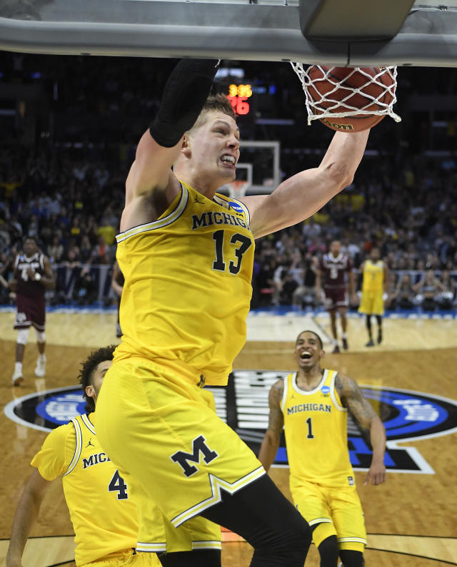Michigan forward Moritz Wagner (13) dunks against Texas A&M during the second half of an NCAA men's college basketball tournament regional semifinal Thursday, March 22, 2018, in Los Angeles. (AP Photo/Alex Gallardo)