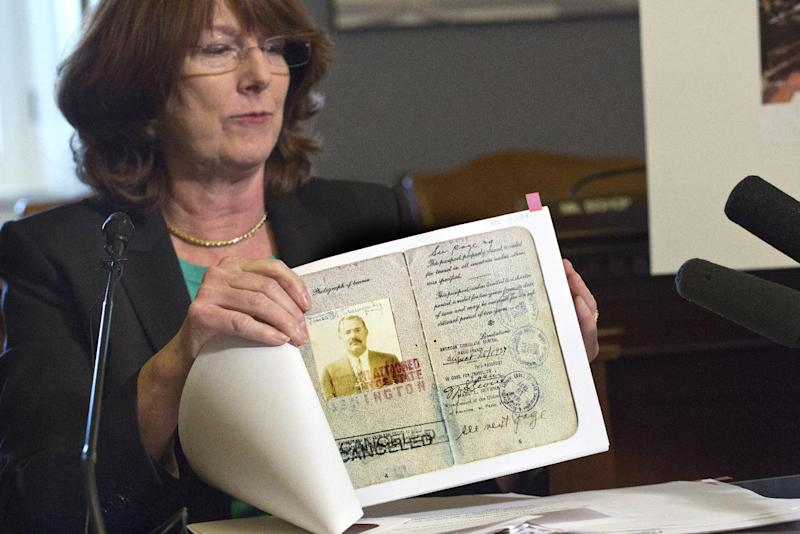 General editor of the Hemingway Letters Project Sandra Spanier, a professor of English at Penn State University, discusses efforts to preserve documents belonging to Ernest Hemingway that have been housed for decades at the author's former estate in Cuba, on Capitol Hill in Washington, Monday, May 6, 2013. A copy of Hemingway's passport is displayed. (AP Photo/J. Scott Applewhite)