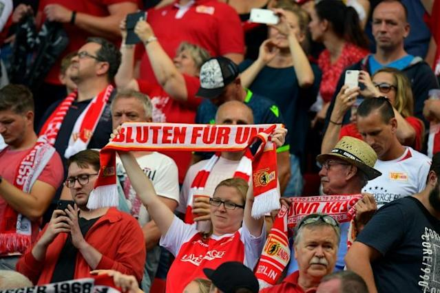 Union Berlin's fans protested against RB Leipzig's ownership with a silent opening quarter of an hour (AFP Photo/Tobias SCHWARZ)