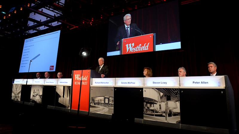 Westfield recommends controversial merger