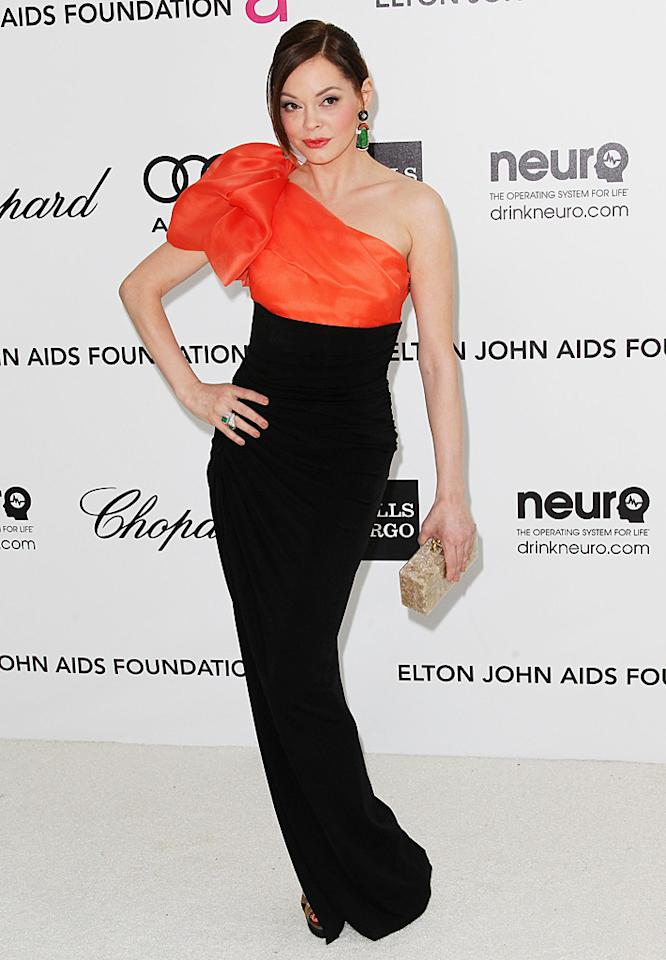 Rose McGowan flaunted her fab frame in a Paule Ka gown and unseen Sergio Rossi heels at Elton's bash.