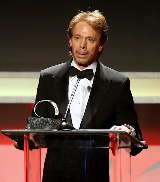 "FILE- In this Dec. 12, 2013 file photo, producer Jerry Bruckheimer accepts the 27th Annual American Cinematheque Award on stage, in Beverly Hills, Calif. After more than two decades with Disney, where he produced the juggernaut ""Pirates of the Caribbean"" and ""National Treasure"" film franchises among many box-office hits, Bruckheimer begins a new partnership with Paramount in March 2014. Bruckheimer Films has 40 projects cooking at any one time; the TV division has at least 10 scripts in development. (Photo by Paul A. Hebert/Invision/AP, File)"