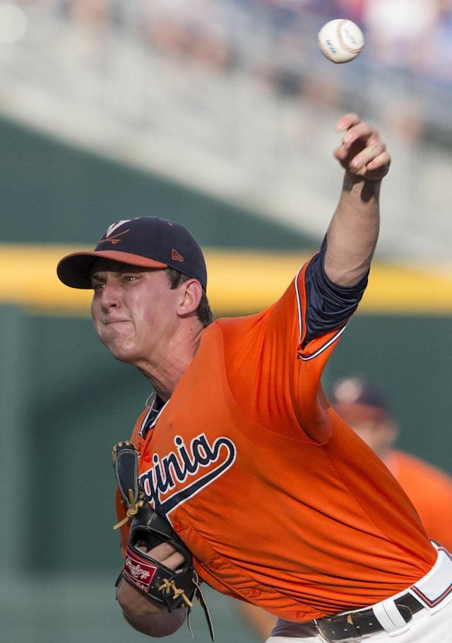 Virginia pitcher Brandon Waddell delivers against TCU in the inning of an NCAA baseball College World Series game in Omaha, Neb., Tuesday, June 17, 2014. (AP Photo/Nati Harnik)