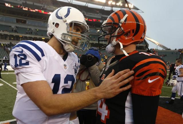 Indianapolis Colts quarterback Andrew Luck (12) meets with Cincinnati Bengals quarterback Andy Dalton (14) after the Bengals defeated the Colts 42-28 in an NFL football game, Sunday, Dec. 8, 2013, in Cincinnati. (AP Photo/David Kohl)