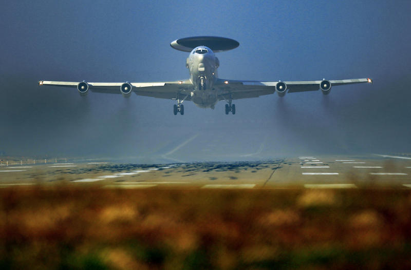 A Nato AWACS plane takes off the NATO Airbase in Geilenkirchen, Germany, Wednesday, March 12, 2014. AWACS planes flying out of Geilenkirchen to patrol over Romania and Poland. (AP Photo/Frank Augstein)
