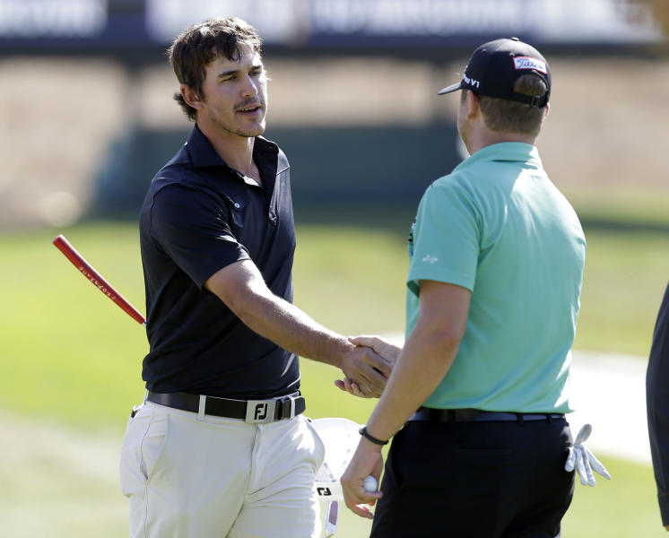 Brooks Koepka, left, shakes hands with Brice Garnett after they both finished their rounds on the ninth green during the second round of the Frys.com Open golf tournament on Friday, Oct. 11, 2013, in San Martin, Calif. (AP Photo/Marcio Jose Sanchez)