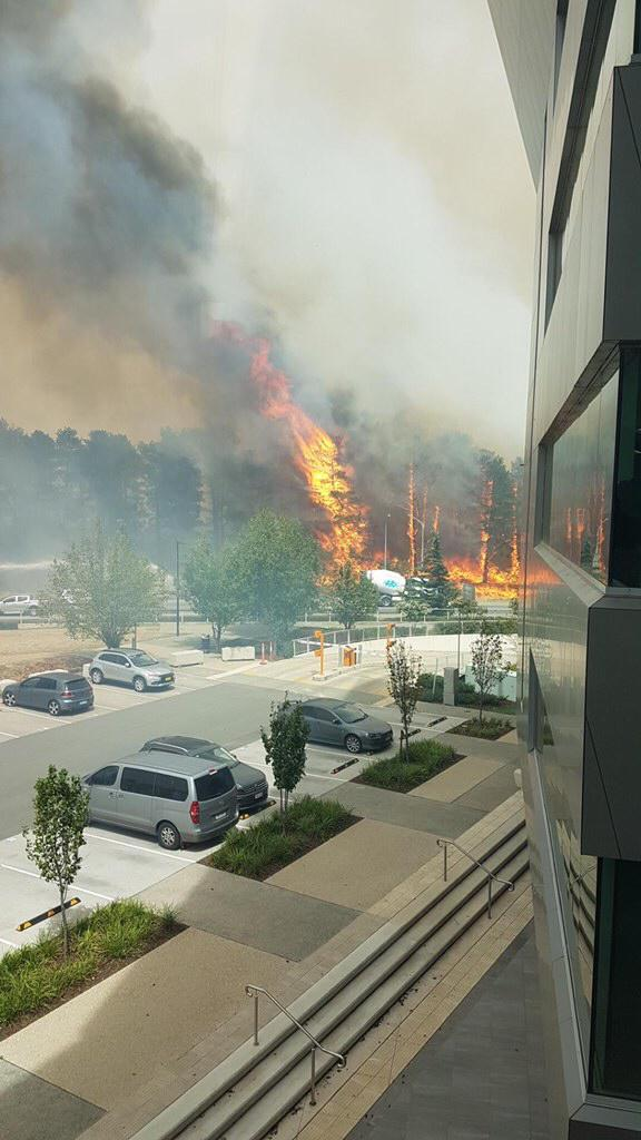 A fire burns near offices on Brindabella Circuit, sending smoke billowing into the air. Source: Twitter/@yellekau