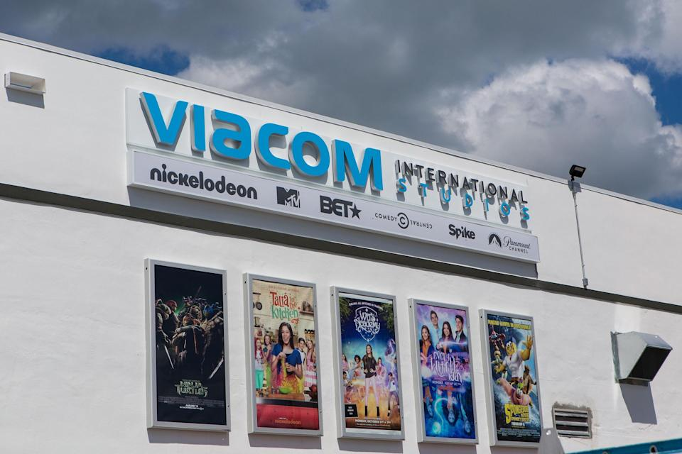 Viacom international studio building with five movie posters and a partly cloudy sky above.
