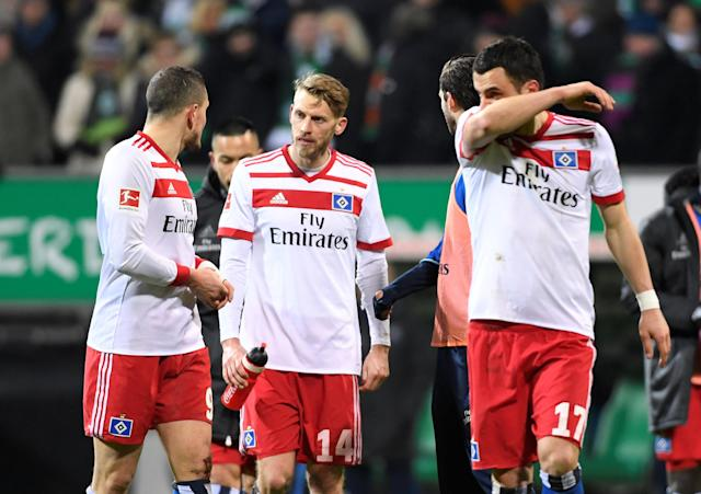 Soccer Football - Bundesliga - Werder Bremen vs Hamburger SV - Weser-Stadion, Bremen, Germany - February 24, 2018 Hamburg's Kyriakos Papadopoulos, Aaron Hunt and team mates look dejected at the end of the match REUTERS/Fabian Bimmer DFL RULES TO LIMIT THE ONLINE USAGE DURING MATCH TIME TO 15 PICTURES PER GAME. IMAGE SEQUENCES TO SIMULATE VIDEO IS NOT ALLOWED AT ANY TIME. FOR FURTHER QUERIES PLEASE CONTACT DFL DIRECTLY AT + 49 69 650050