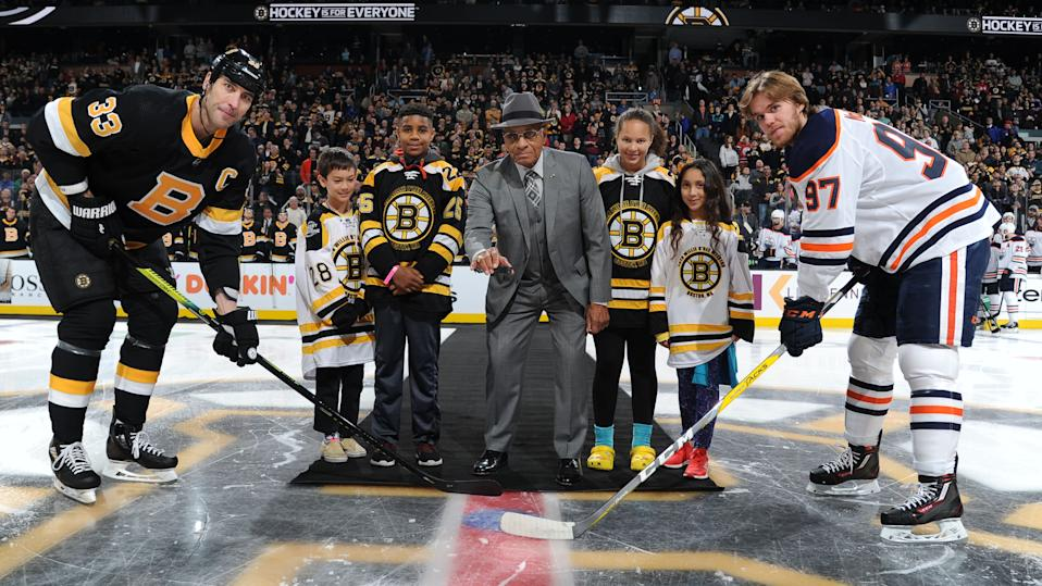BOSTON, MA - JANUARY 4: Alumni player Willie O'Ree of the Boston Bruins in honor of Hockey Is For Everyone and the Willie O'Ree Skills Weekend drops the puck before the game against the Edmonton Oilers at the TD Garden on January 4, 2020 in Boston, Massachusetts. (Photo by Steve Babineau/NHLI via Getty Images)