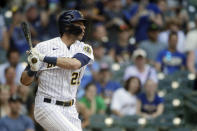 Milwaukee Brewers' Christian Yelich hits an RBI sacrifice fly during the seventh inning of a baseball game against the Pittsburgh Pirates Sunday, June 13, 2021, in Milwaukee. (AP Photo/Aaron Gash)