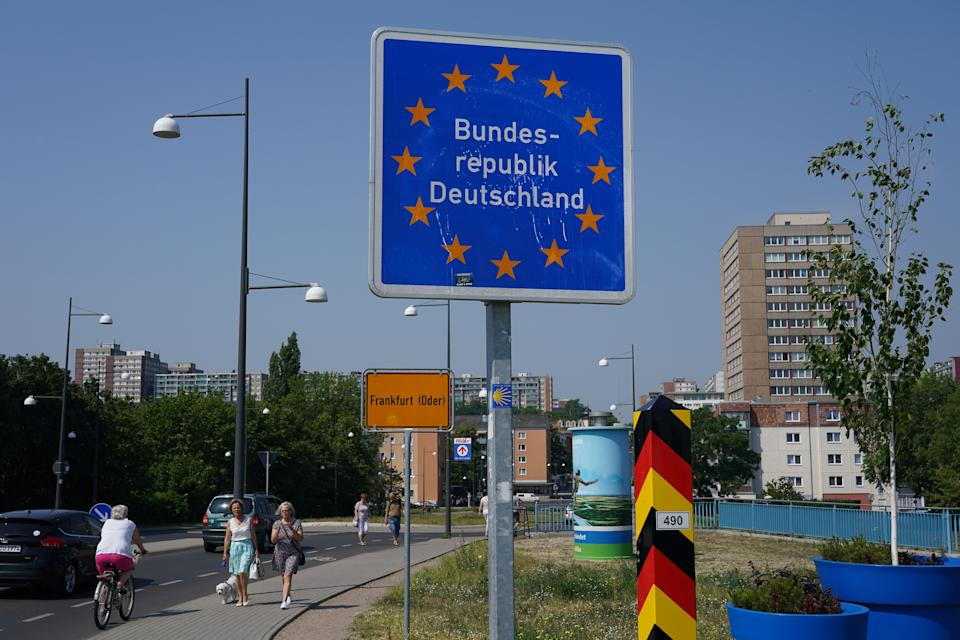 FRANKFURT (ODER), GERMANY - JUNE 13: A sign marks the German border at the Oder River at the border to Poland hours after Polish authorities reopened the border during the novel coronavirus pandemic on June 13, 2020 in Frankfurt (Oder), Germany. Poland lifted restrictions on its border crossings to Germany, Austria and Slovakia starting at midnight, last night that had been in place since March to stem the spread of the virus.  (Photo by Sean Gallup/Getty Images)