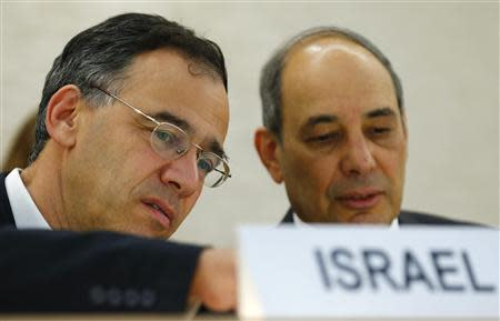 Nitzan, Deputy Attorney General Ministry of Justice of Israel waits with Manor, Israel Ambassador to the U.N. before the Human Rights Council UPR session on Israel at the UN in Geneva