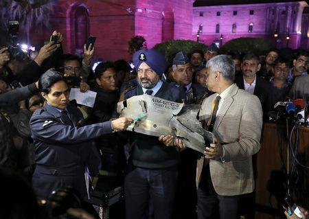Indian Air Force officials display a wreckage of AMRAAM air-to-air missile that they say was fired by Pakistan Air Force fighter jet during a strike over Kashmir on Wednesday, after speaking with the media in the lawns of India's Defence Ministry in New Delhi, India, February 28, 2019. REUTERS/Anushree Fadnavis