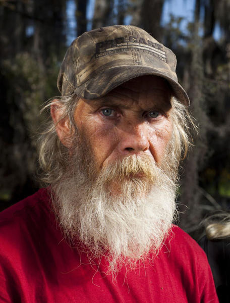 """In this undated image released by History, Mitchell Guist from the series """"Swamp People,"""" is shown. Authorities in Louisiana say a man who starred in the reality television show """"Swamp People"""" died from natural causes. Ascension Parish Sheriff Jeff Wiley says the parish coroner, Dr. John Fraiche, made that determination after a preliminary autopsy on Mitchell Guist. Guist, who appeared in segments of the """"Swamp People"""" with his brother, Glenn, died after collapsing Monday, May 14, 2012 while working on a houseboat he was building on Belle River. (AP Photo/History, Zach Dilgard)"""