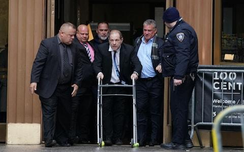 Harvey Weinstein leaves Manhattan Criminal Court, using a walker, following a hearing in New York. - A woman who alleges disgraced Hollywood mogul Harvey Weinstein sexually assaulted her when she was 16 filed suit against him on December 19, 2019 and rejected a settlement reached by other accusers. - Credit: AFP