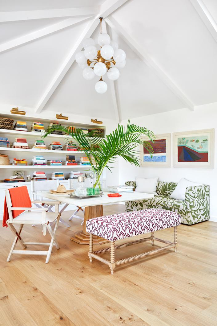 """<div class=""""caption""""> In the family room, A Jayson Home bench wears a Vaughan print. Bunny Williams Home table. </div> <cite class=""""credit"""">Pernille Loof</cite>"""