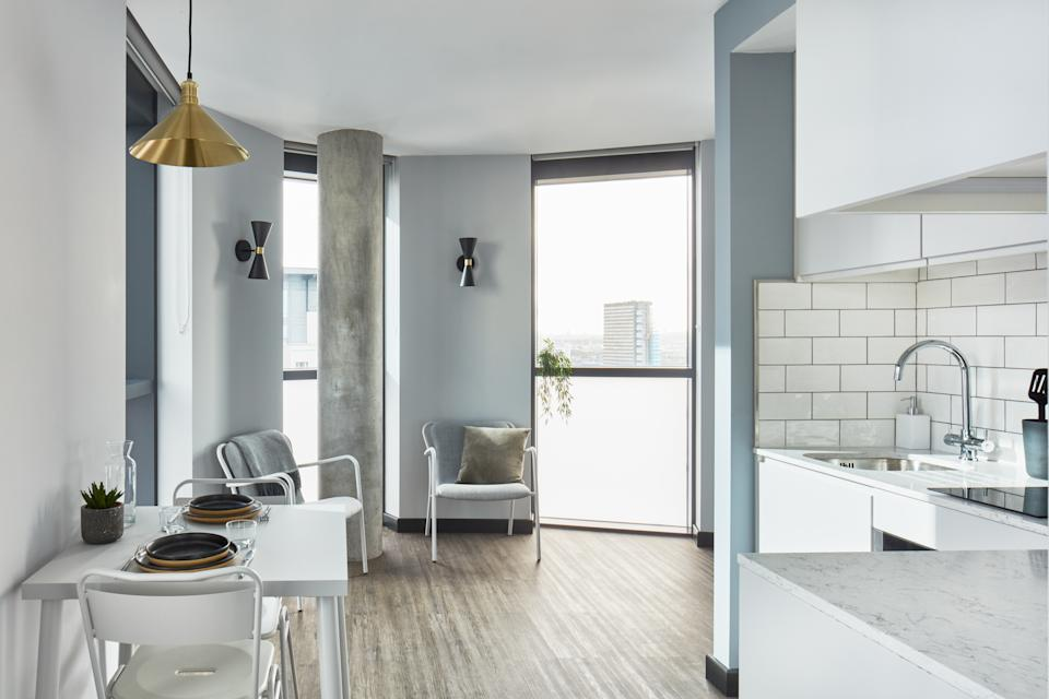 A kitchenette and dining area in a unit at The Collective Canary Wharf.