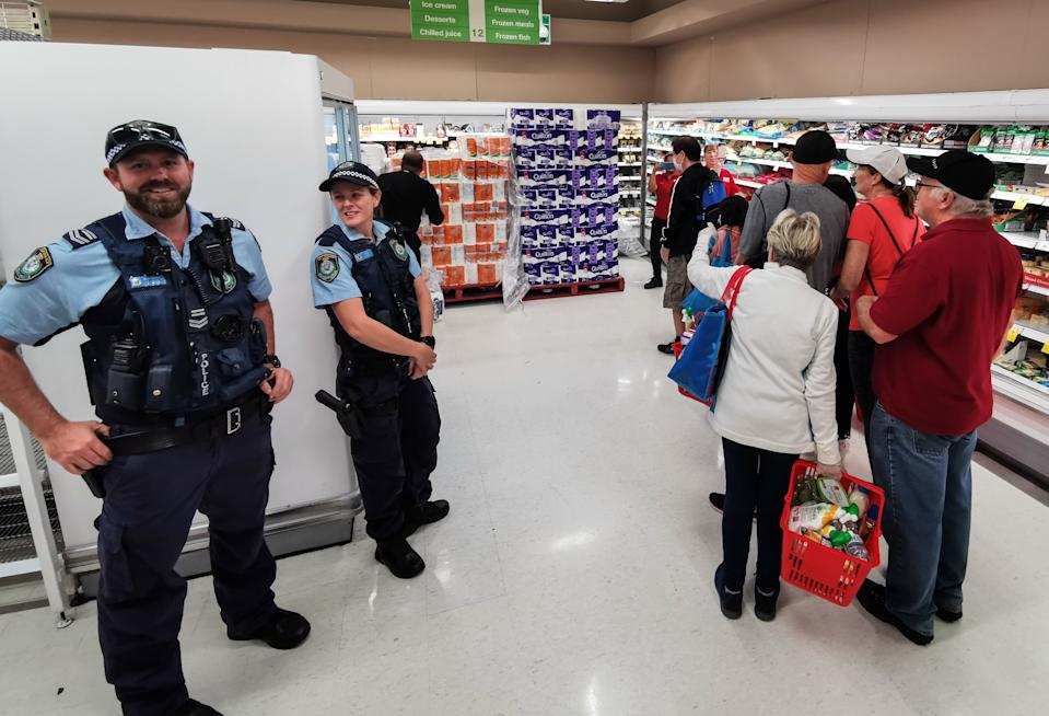 Police on standby inside a Coles supermarket following unsociable behaviour over toilet paper. Source: AAP