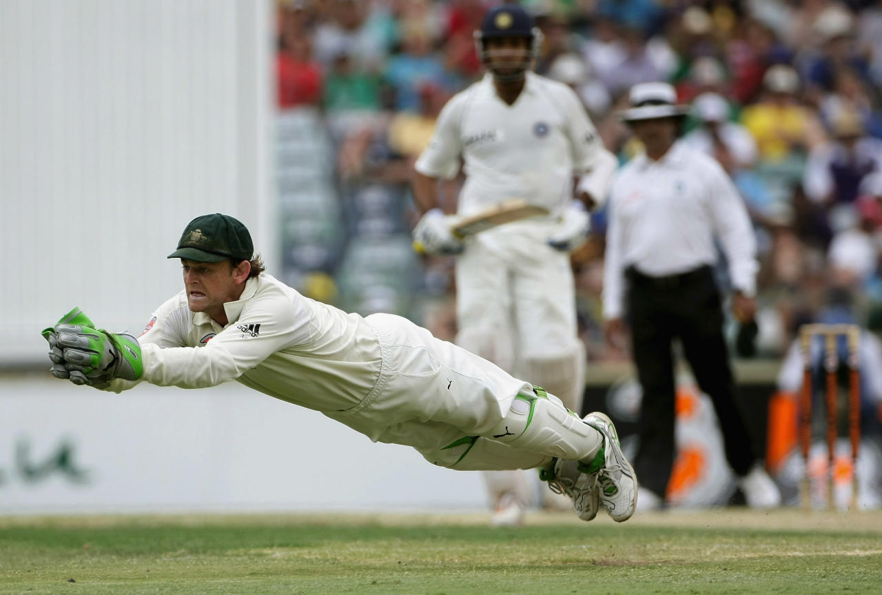 PERTH, AUSTRALIA - JANUARY 18:  Australian wicket keeper Adam Gilchrist makes a diving catch to dismiss Mahendra Dhoni of India off the bowling of Andrew Symonds during day three of the Third Test match between Australia and India at the WACA on January 18, 2008 in Perth, Australia.  (Photo by Robert Cianflone/Getty Images)