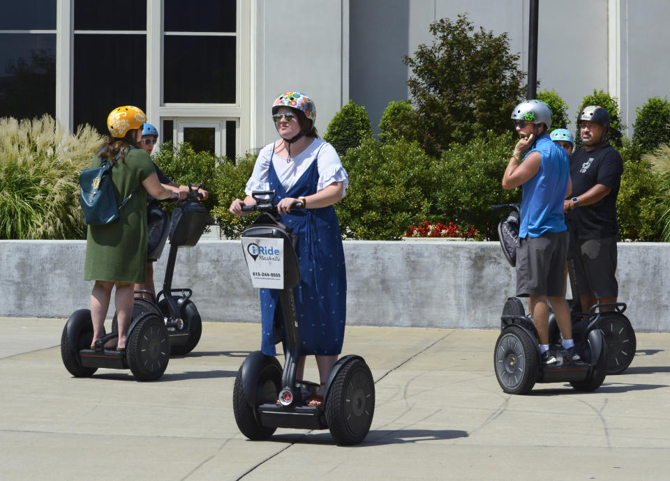 NASHVILLE, TENNESSEE - SEPTEMBER 2, 2019: Tourists riding Segway PT personal transporters prepare to depart from a stop on a guided Segway tour in downtown Nashville, Tennessee. (Photo by Robert Alexander/Getty Images)