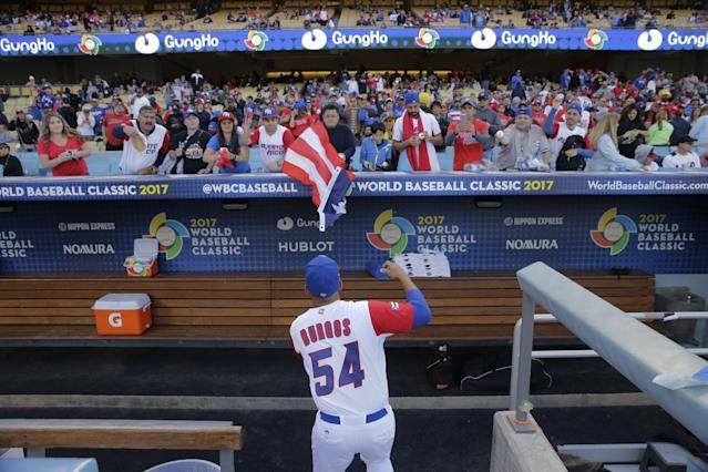 <p>Puerto Rico pitcher Hiram Burgos signs autographs before the team's final against the United States in the World Baseball Classic, in Los Angeles, Wednesday, March 22, 2017. (AP Photo/Jae C. Hong) </p>