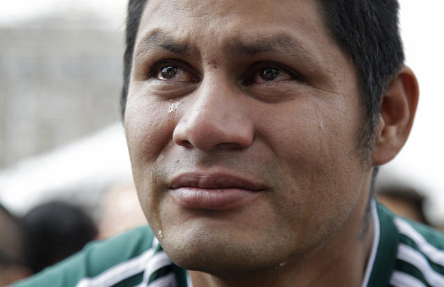 <p>Tears run down the face of a Mexico soccer fan as he watches Brazil take the lead during a live broadcast of the Russia World Cup game between Mexico and Brazil, in Mexico City's Zocalo plaza, Monday, July 2, 2018. (AP Photo/Anthony Vazquez) </p>