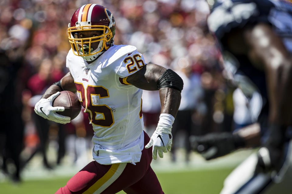 LANDOVER, MD - SEPTEMBER 15: Adrian Peterson #26 of the Washington Redskins runs with the ball against the Dallas Cowboys during the first half at FedExField on September 15, 2019 in Landover, Maryland. (Photo by Scott Taetsch/Getty Images)
