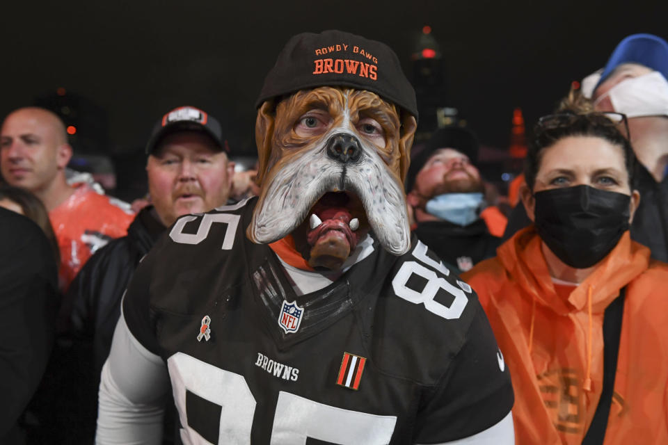 Cleveland Browns fans wait for the team to make its first round pick in the NFL football draft Thursday, April 29, 2021, in Cleveland. The Browns chose Northwestern cornerback Greg Nerwsome II. (AP Photo/David Dermer)