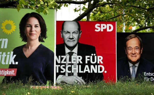 three elections posters show top candidate for chancellor of the Greens Annalena Baerbock, left, Social Democratic top candidate for chancellor Olaf Scholz, center, and Christian Democratic top candidate for chancellor Armin Laschet (Photo: AP Photo / Michael Sohn)