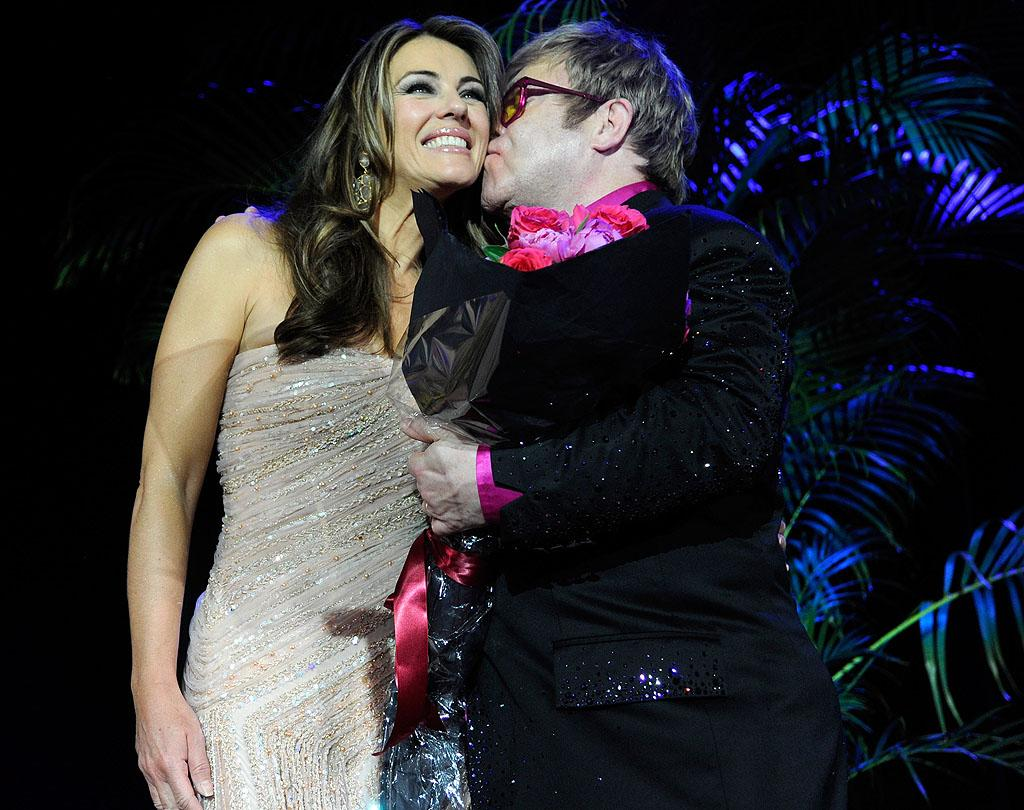 """<p class=""""MsoNormal"""">Brits unite! Legendary musician Elton John and model/actress Elizabeth Hurley cozied up at the Hot Pink Party, a charity event to raise funds for the Breast Cancer Research Foundation. The soiree, which took place Tuesday at New York's Waldorf-Astoria, featured entertainment by none other than the Rocket Man himself and raised a whopping $5 million for the good cause. <span style="""""""">(4/30/2012)</span></p>"""