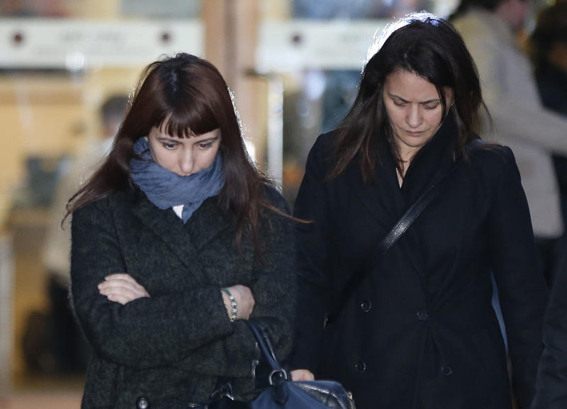 Italian sisters Francesca, left, and Elisabetta Grillo, right, former personal assistants (PA) to English broadcaster Nigella Lawson and her former husband art collector Charles Saatchi, leave the Isleworth Crown Court, in west London, Wednesday Nov. 27, 2013, where the Grillo sisters are standing trial over alleged fraud. The PA assistants are accused of committing fraud by abusing their positions and alllegedly using a company credit card for personal gain. (AP Photo/Lefteris Pitarakis)