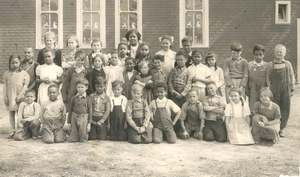 """<span class=""""caption"""">Students of School Section #13 with teacher, Verlyn Ladd, who taught at the school from 1939 to 1958. Class of 1951, Buxton, Raleigh Township, Ontario. </span> <span class=""""attribution""""><span class=""""source"""">(Buxton National Historic Site & Museum)</span>, <span class=""""license"""">Author provided</span></span>"""